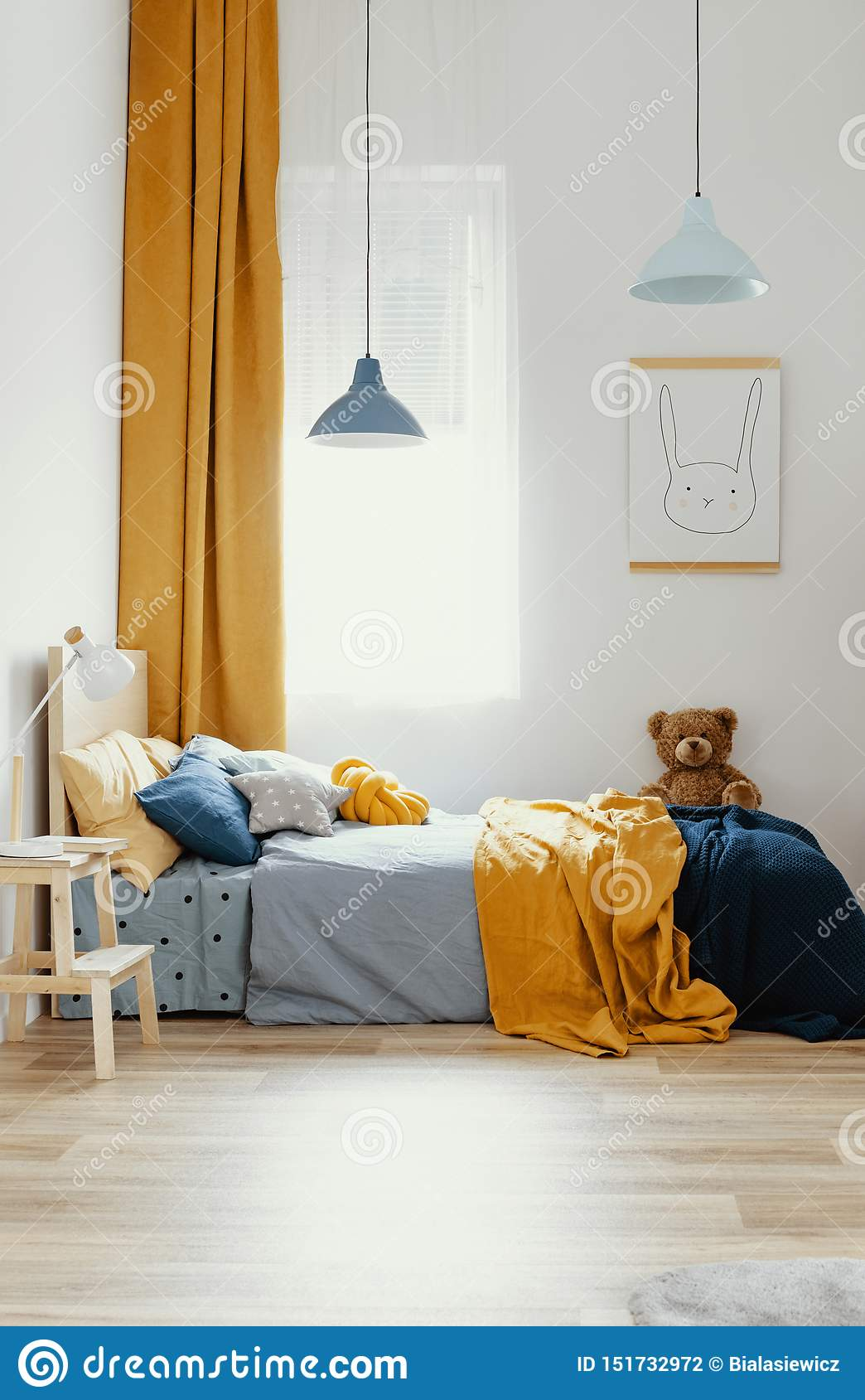 Teddy Bear On Single Wooden Bed In Blue And Orange Bedroom ...
