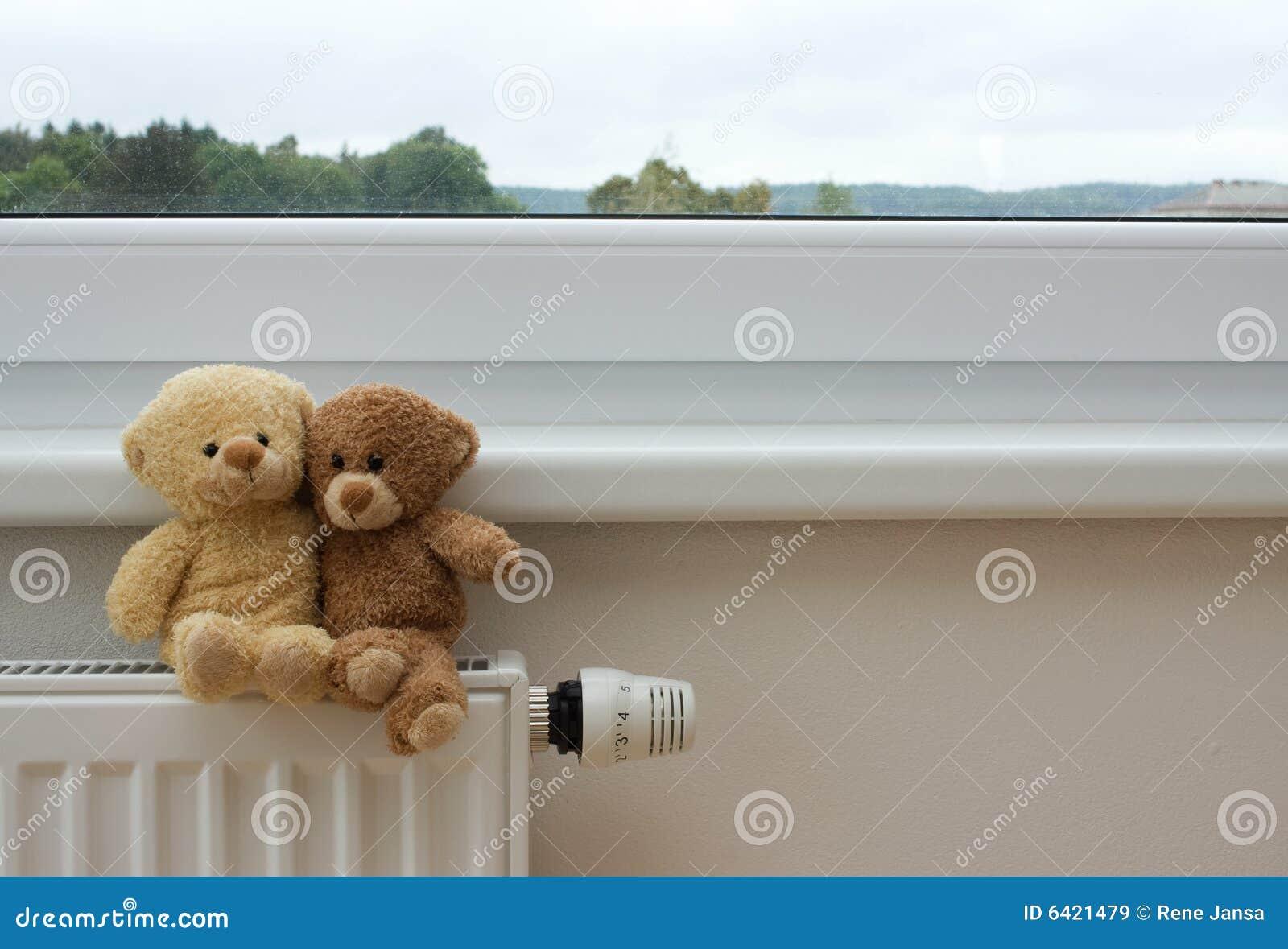 Teddy bears on the heater