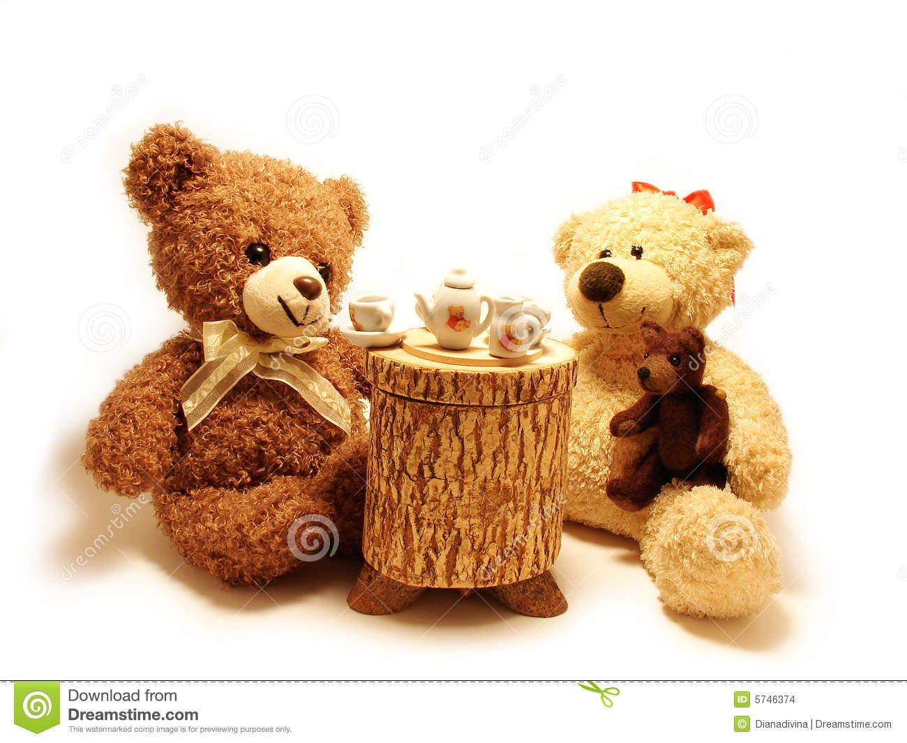 Family of teddy bears having tea-party isolated in white.