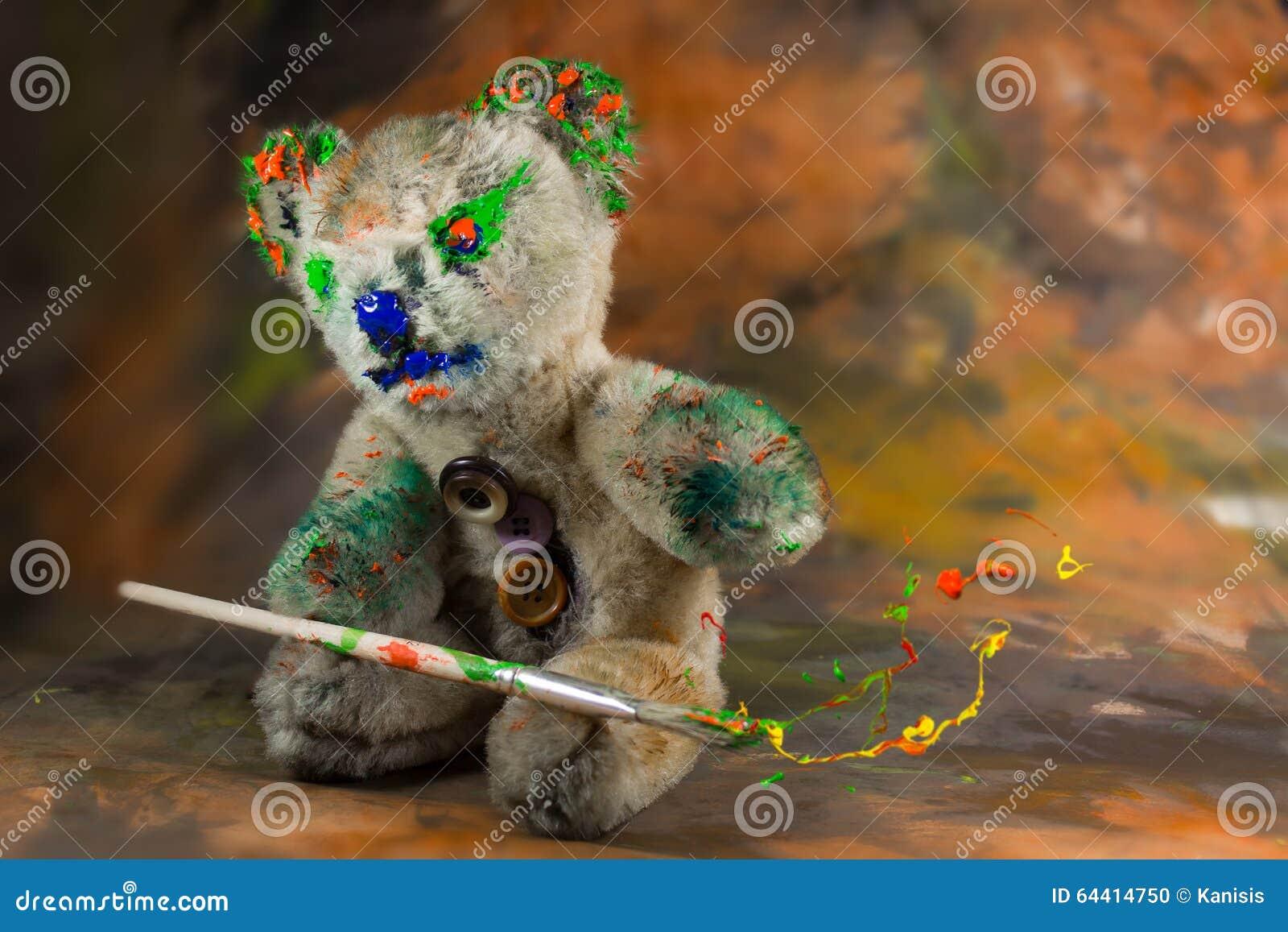 Teddybär Sitzt Und Macht Magie Mit Der Sprengung Der Farbe Stockfoto ...