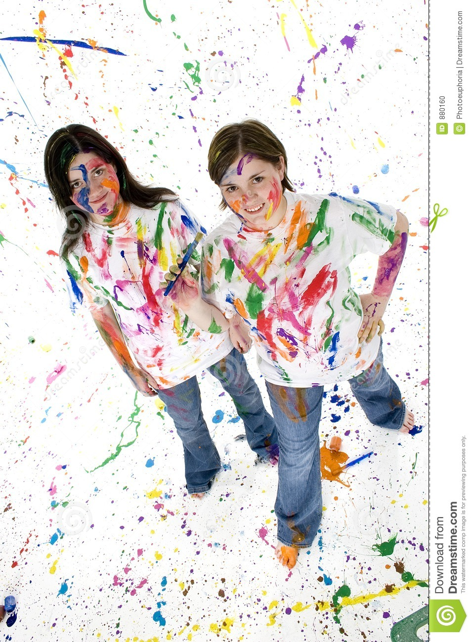 Two beautiful teen girls covered in paint.