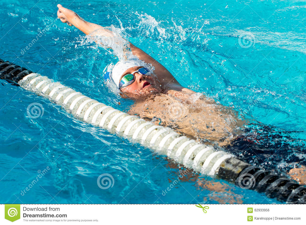 Swimming Pool Action : Teen backstroke swimmer in action stock photo image of