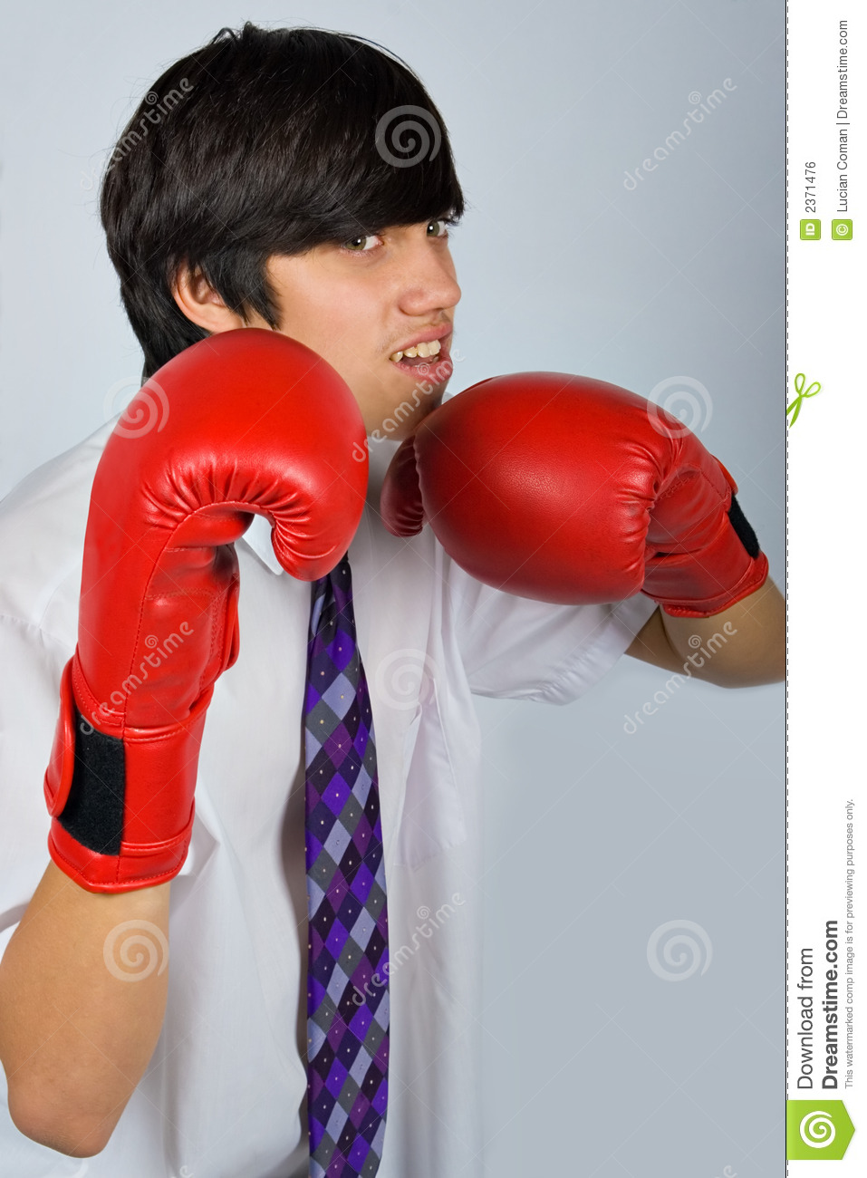 Shiv Naresh Teens Boxing Gloves 12oz: Teen In Boxing Gloves Royalty Free Stock Image