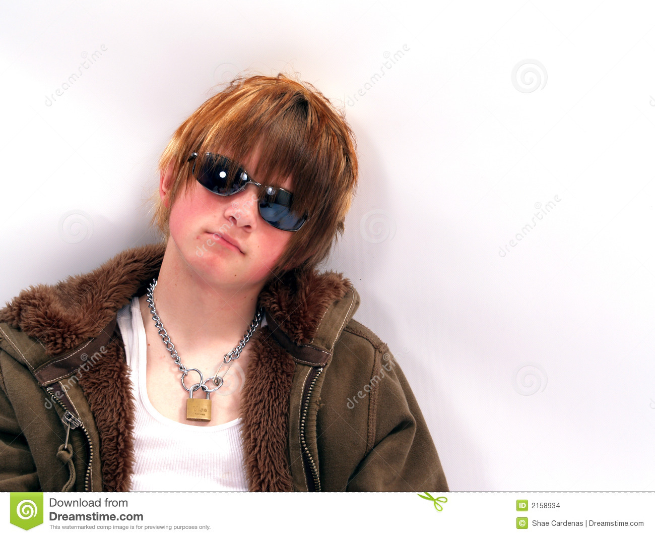 Teen Boy with attitude wearing sunglasses - copy space