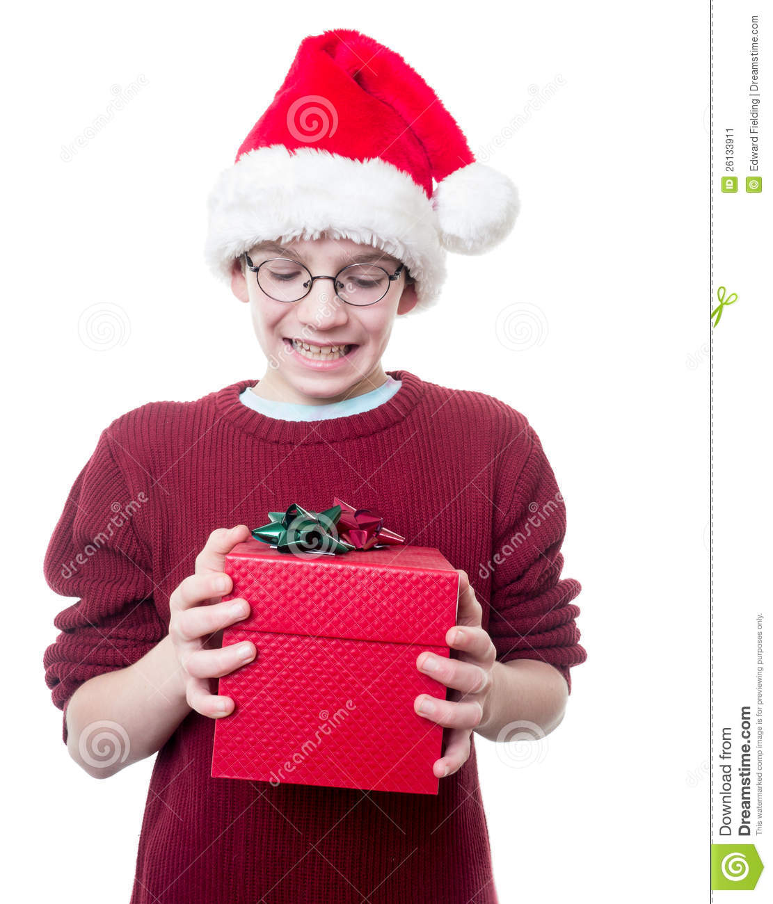 Teen Boy Christmas.Teen Boy With Christmas Hat And Present Stock Image Image