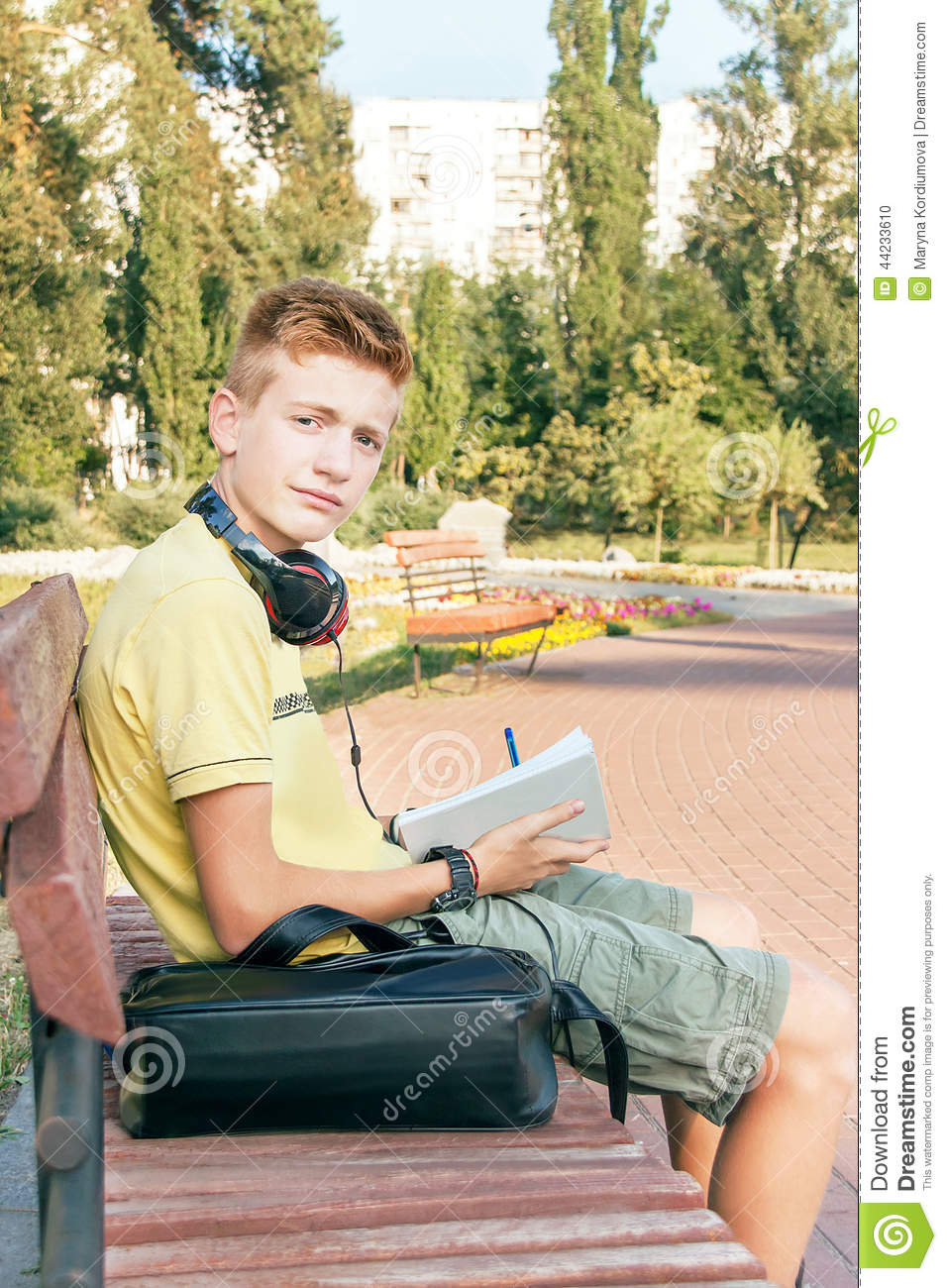 Teen Boy Is Sitting And Writing On The Bench Stock Photo Image 44233610