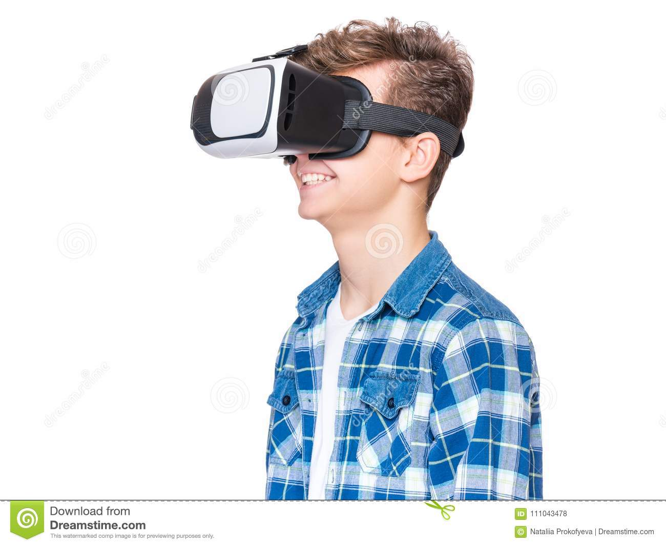 30efef821fe9 Happy teen boy wearing virtual reality goggles watching movies or playing  video games. Cheerful smiling teenager looking in VR glasses.