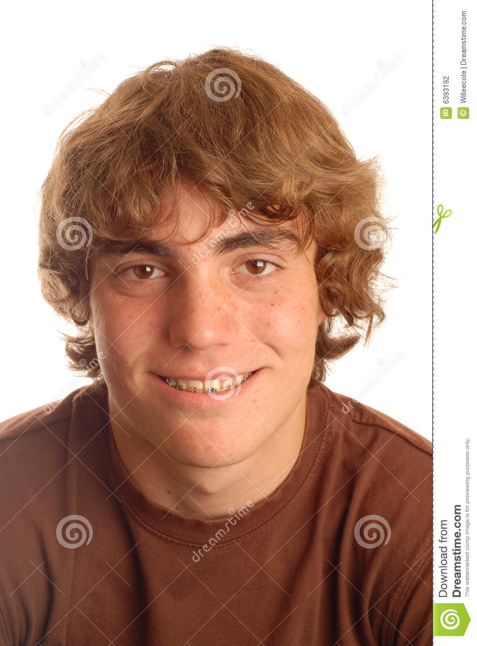 Attractive fourteen year old boy with braces on his teeth