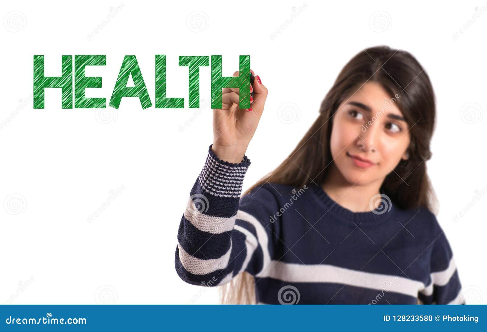 Teen college girl writing health on transparent screen