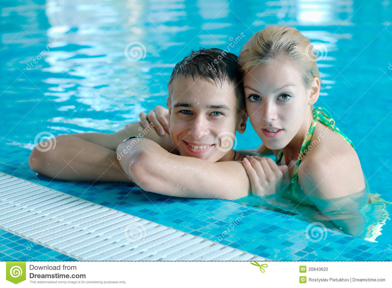 Teen couple at the swimming pool