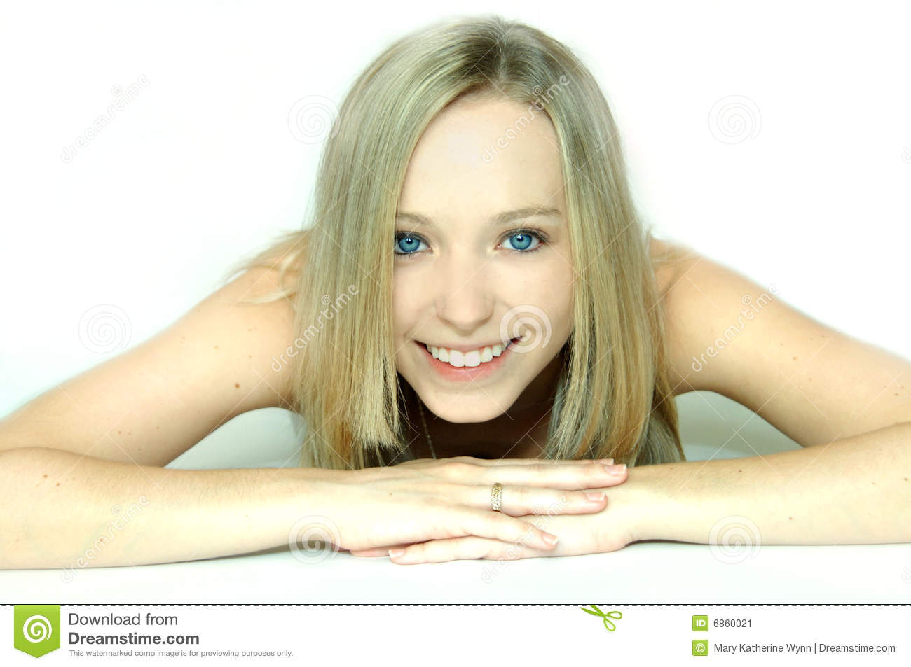 Face Of A Beautiful Blond Young Woman With Blue Eyes