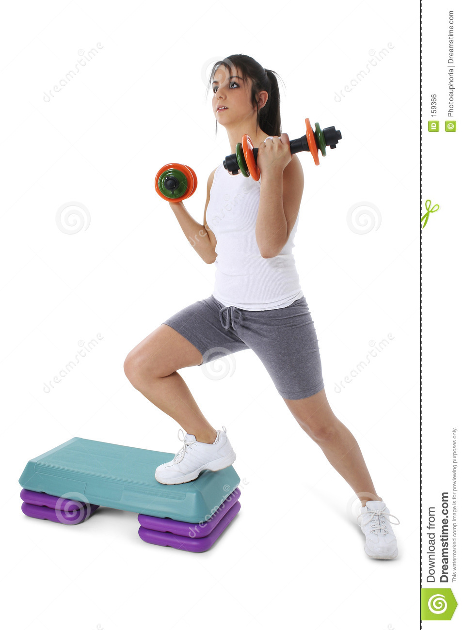 Teen Girl On Aerobic Step With Hand Weights