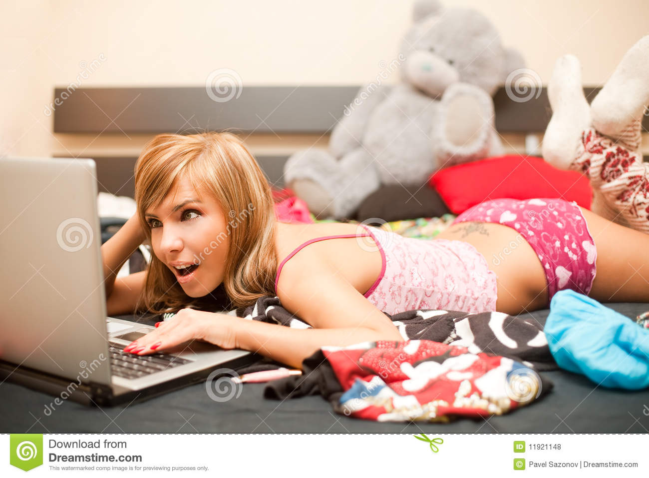 Teen Girl In Bed With Laptop Royalty Free Stock Photos