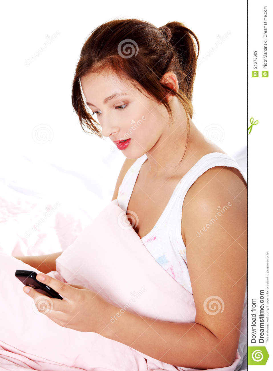 Teen Girl Reading In Bed