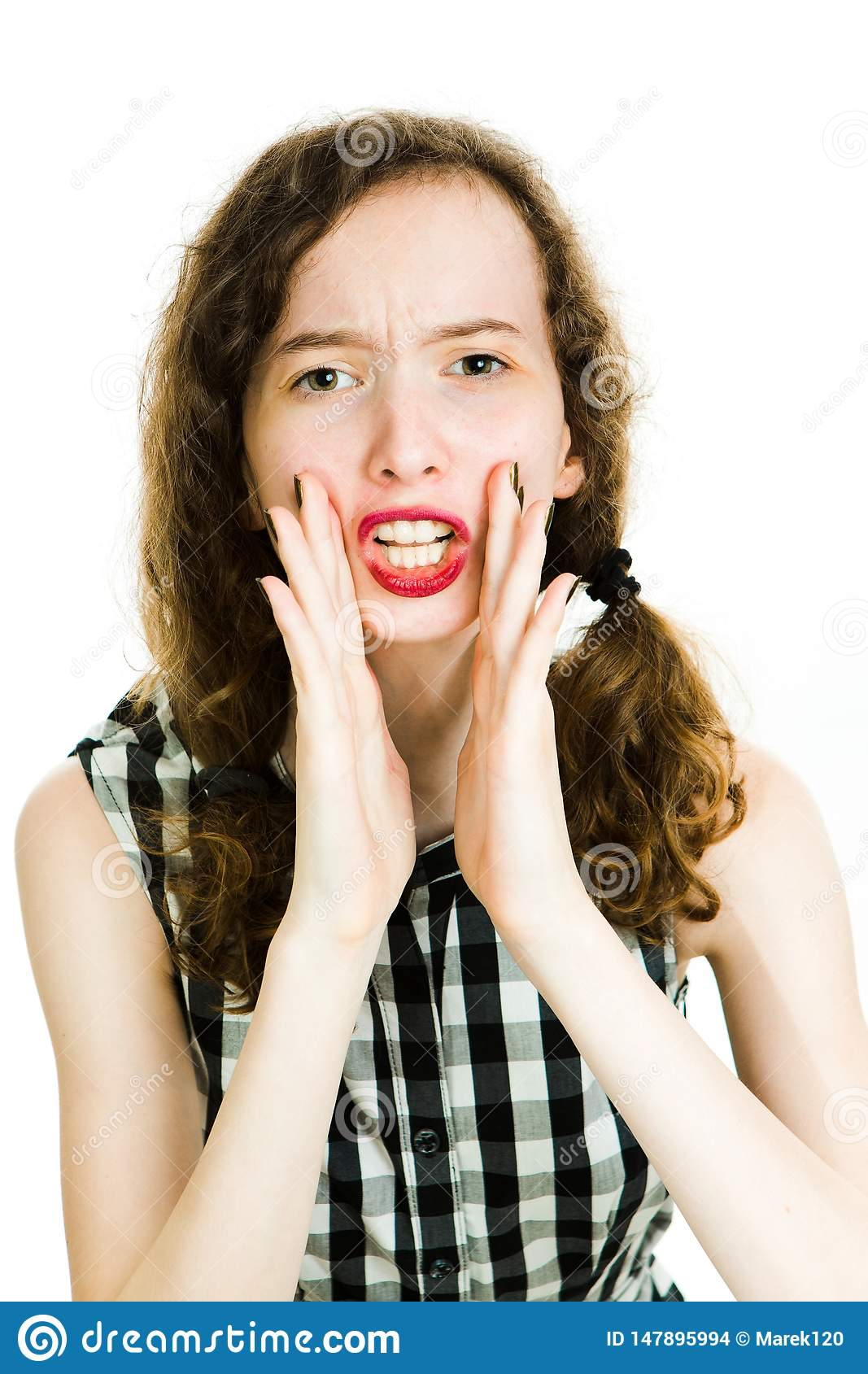 Teen girl in black checkered dress and dark make up makes shouting
