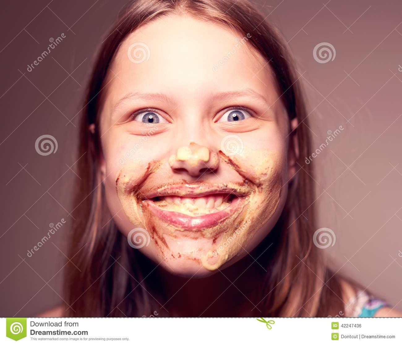 Teen Girl With Chocolate On Her Face Stock Photo - Image: 42247436