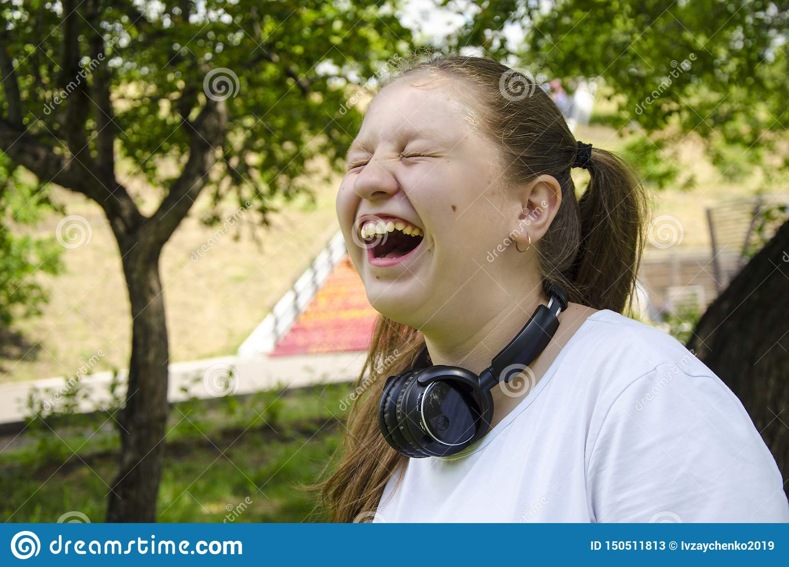 Teen girl explosive emotions. Summer day