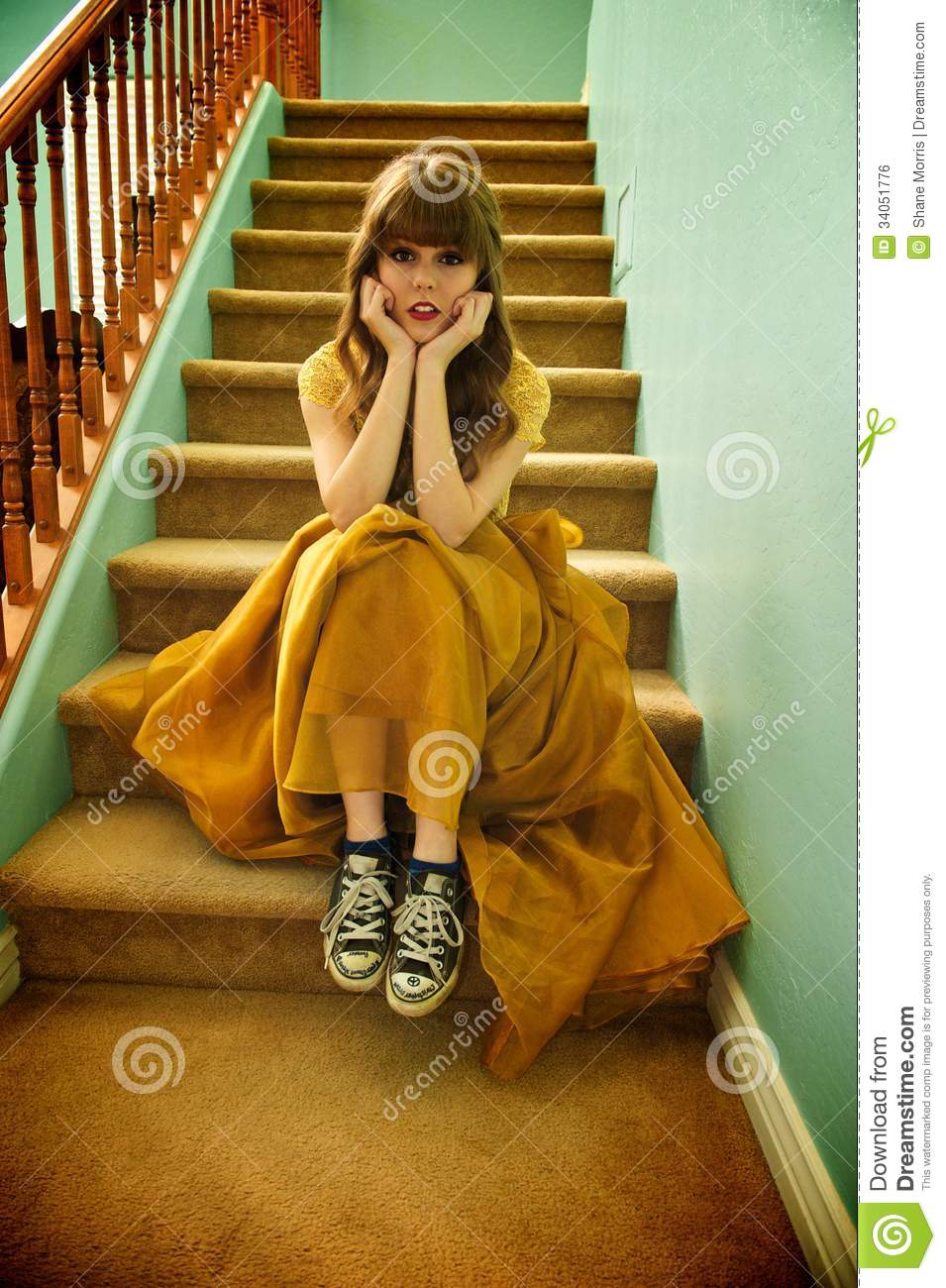 teen girl with formal prom gown and sneakers royalty free