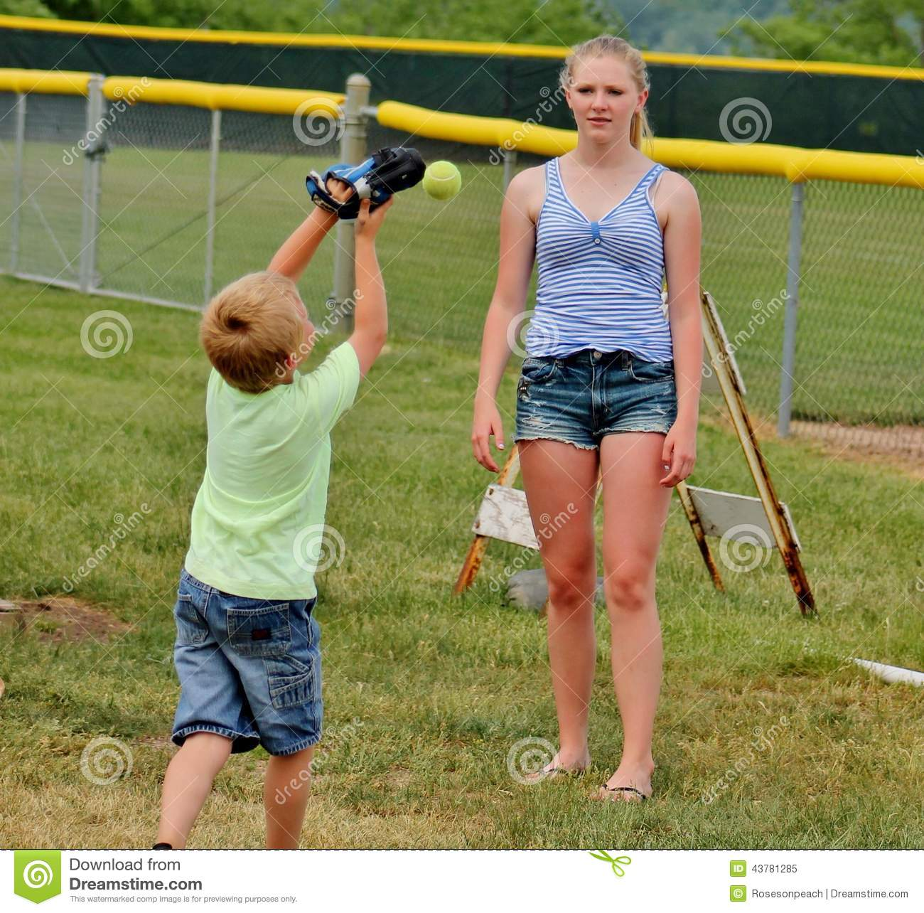 Teen Girl And Little Brother Playing Catch Stock Photo Image