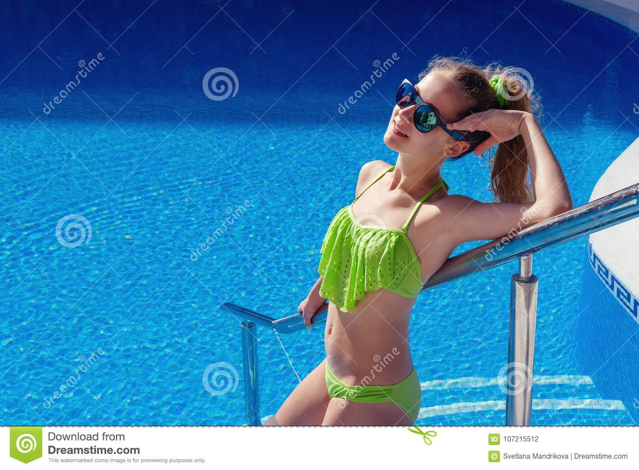 Teen girl relaxing near swimming pool stock photo image - Where is my nearest swimming pool ...