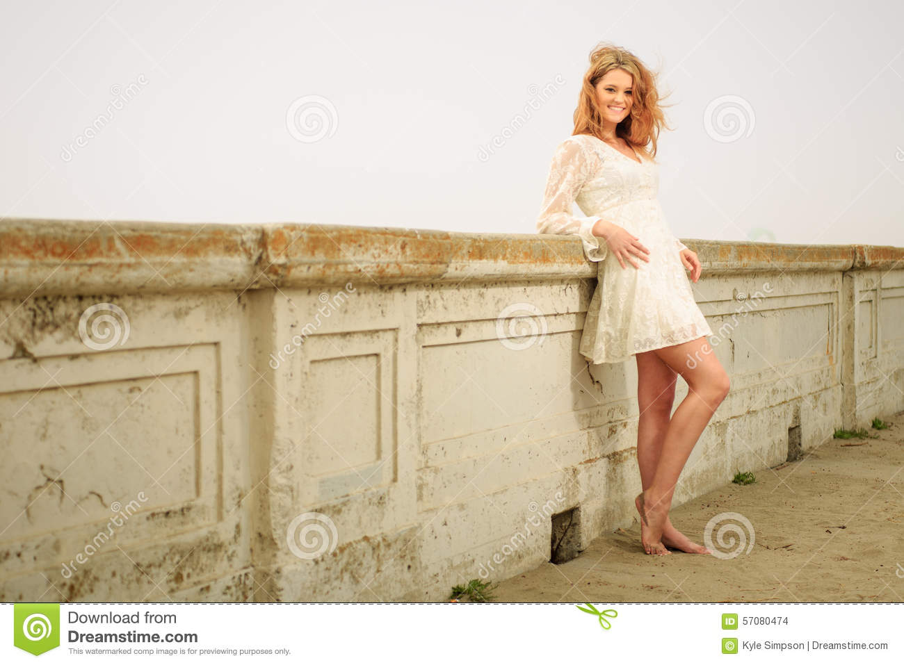 teen girl relaxing on a wall barefoot stock photo - image of