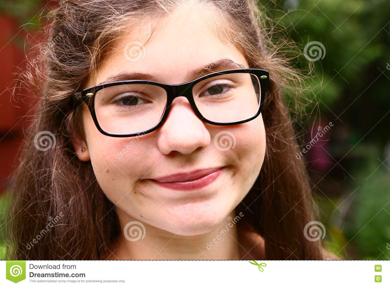 Teen Girl With Short Sight Glasses And Brown Thick