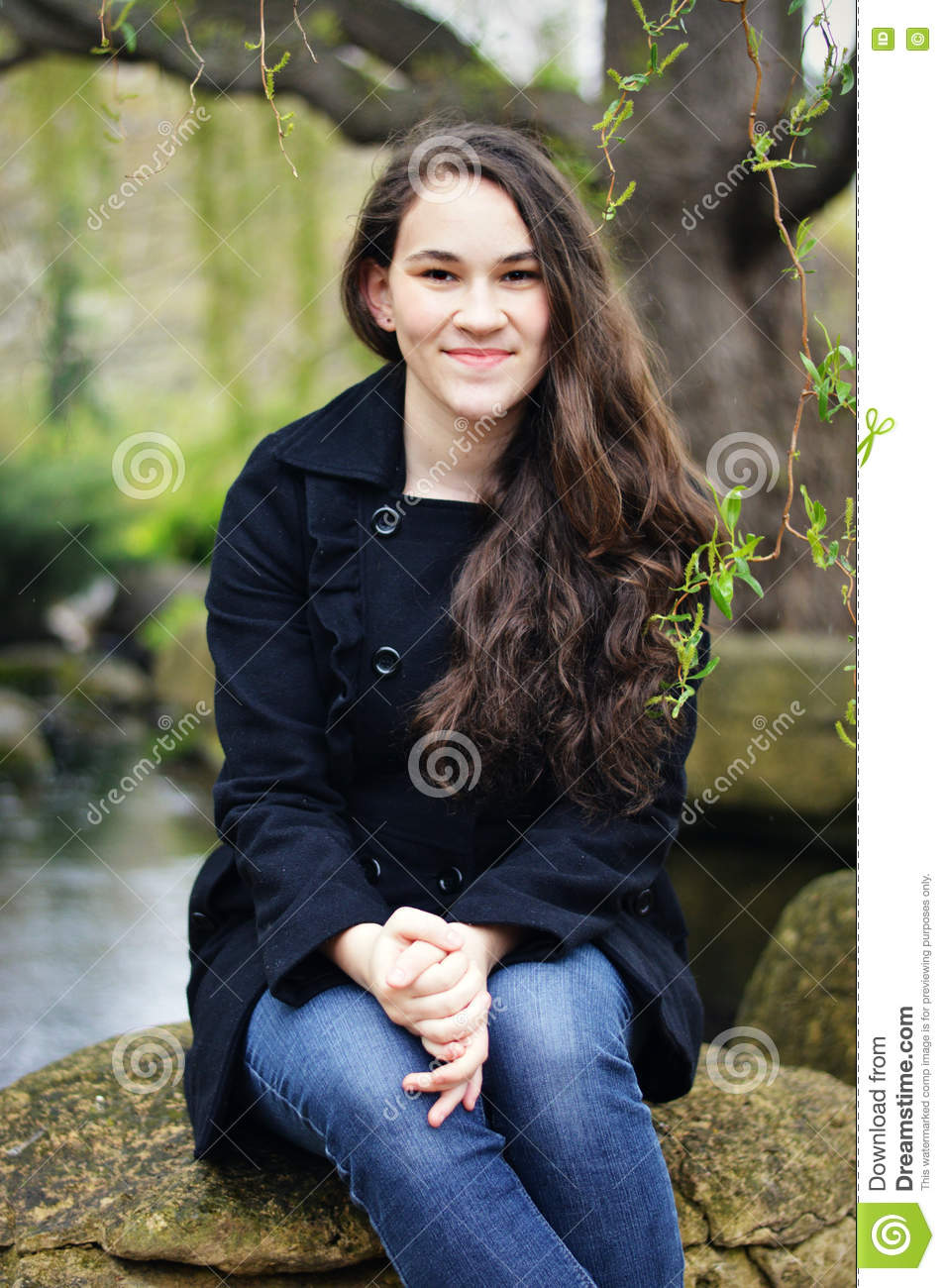 Girl sitting on rock suite