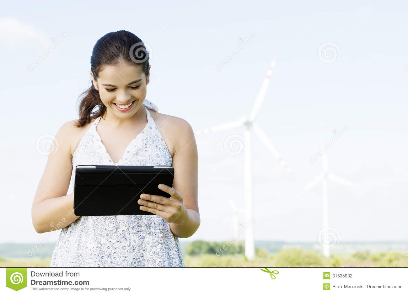 teen girl next to wind turbine