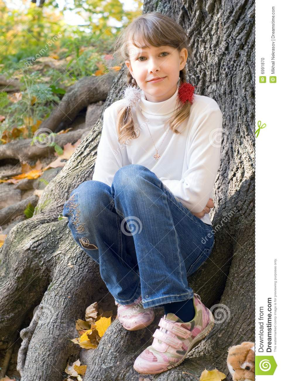 Teen Girl Under The Tree Stock Photo