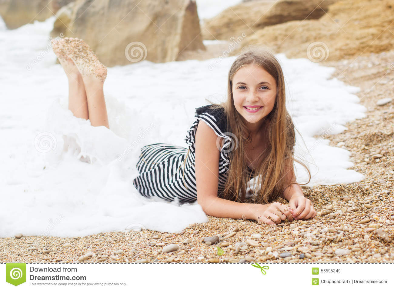 Teen girl is wearing stripped dress on the beach stock Cute teenage girls pics
