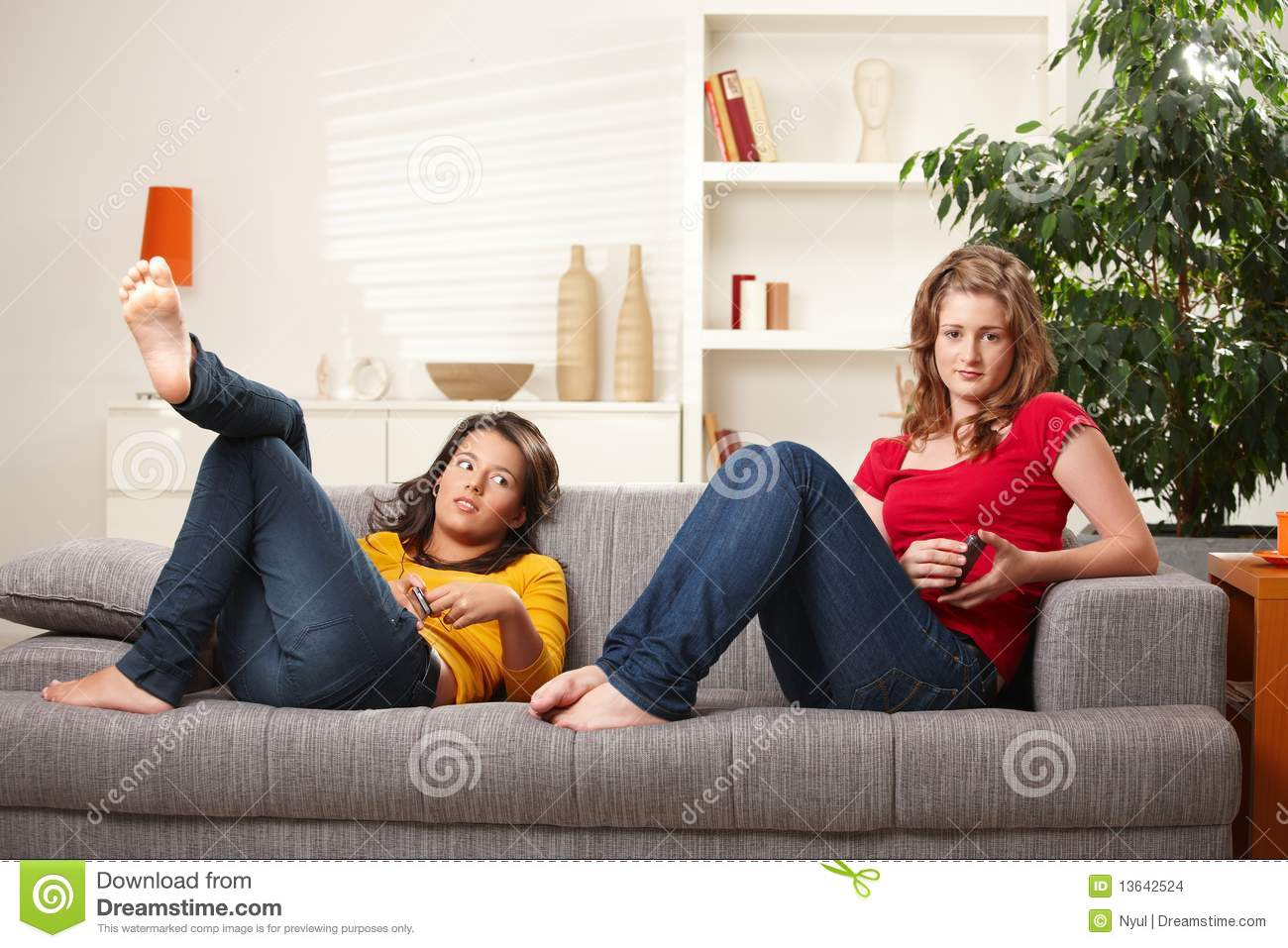 Teen Girls Relaxing On Sofa Stock Images - Image: 13642524