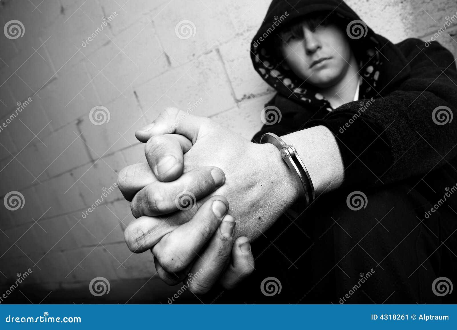 Teen in handcuffs