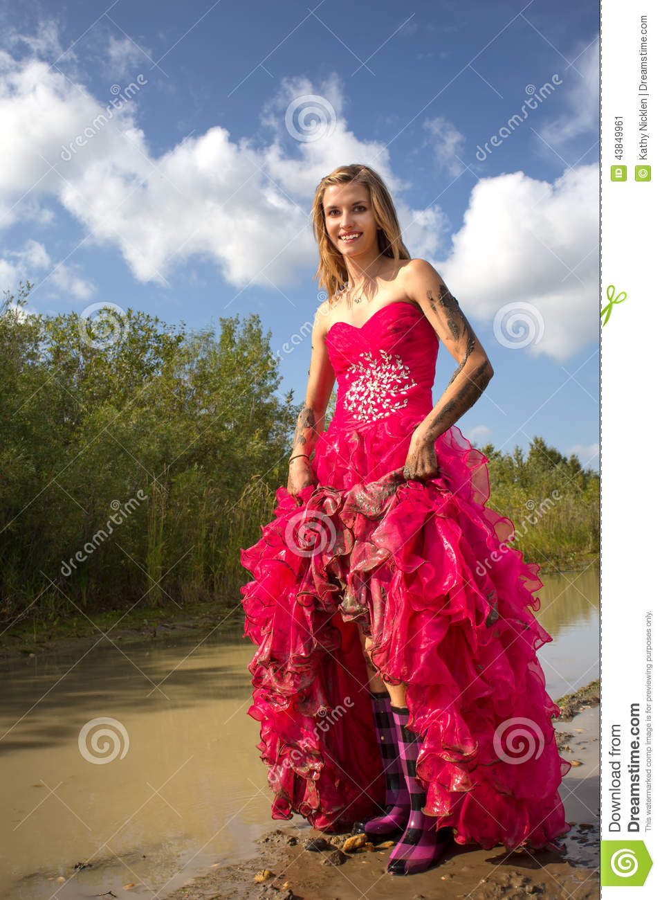 Teen holding up prom dress stock image. Image of long - 43849961