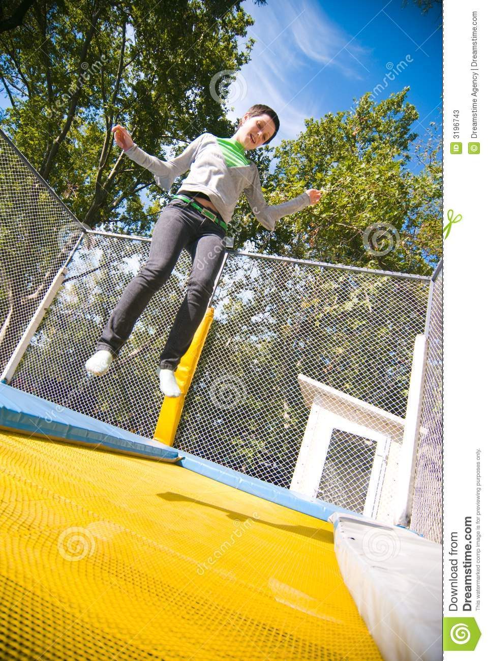 teen jumping on trampoline stock photos image 3196743