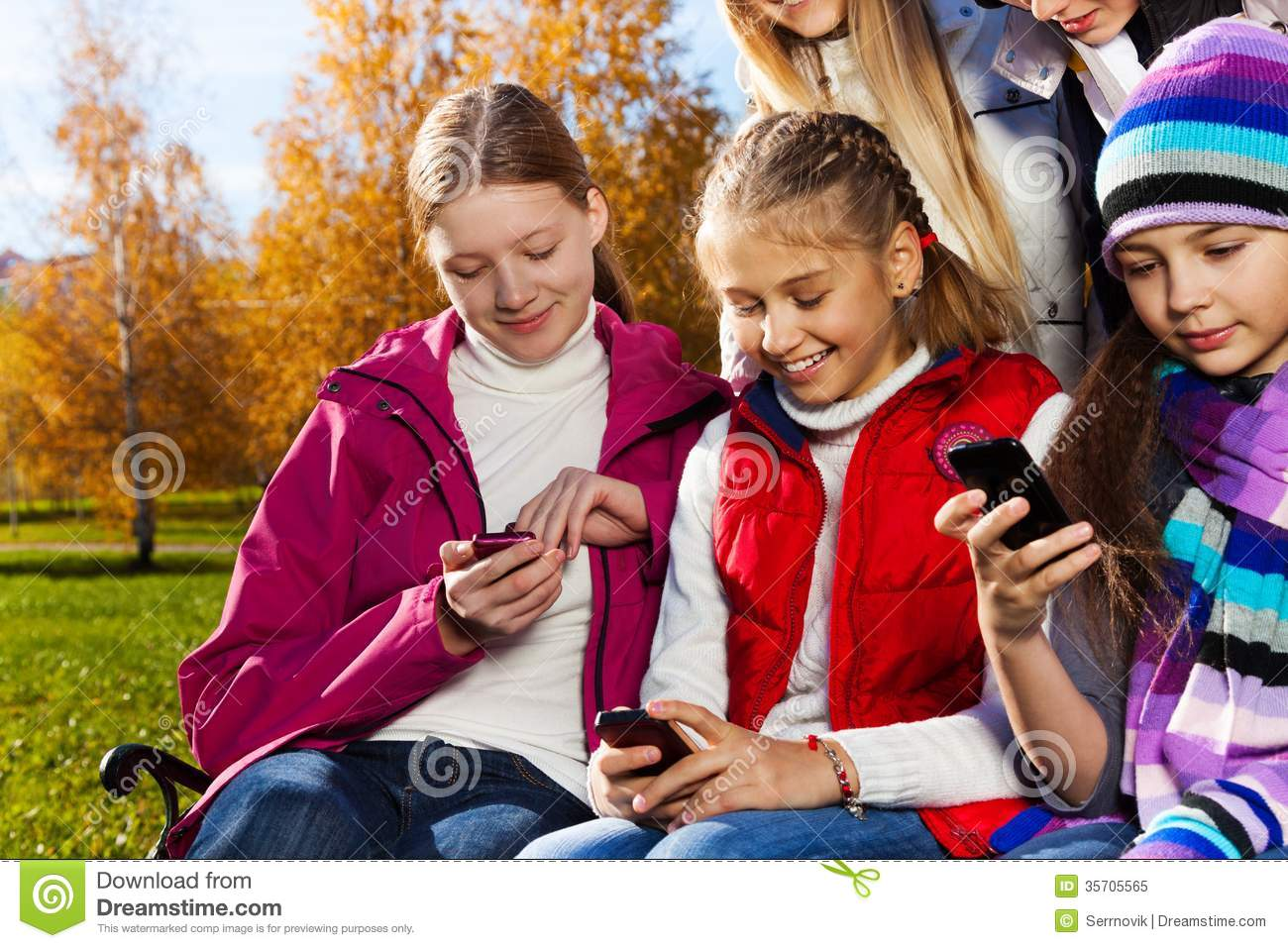 teen kids busy with cell phones royalty free stock photo
