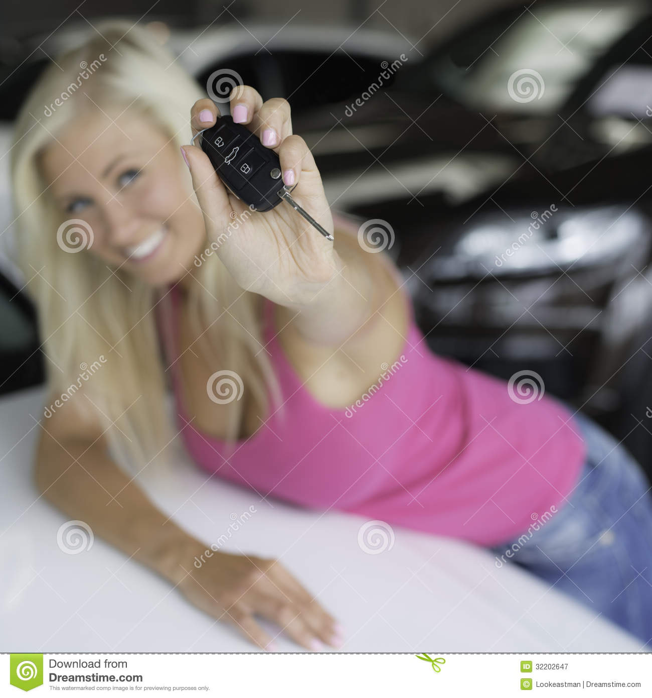 Happy teen, out of focus, flashing car key