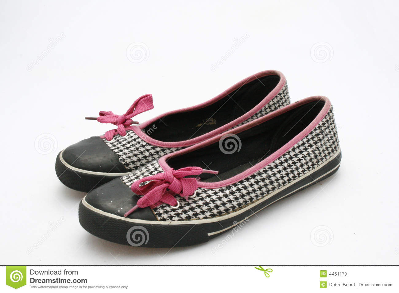 pair of black and white checkered shoes with pink shoelaces