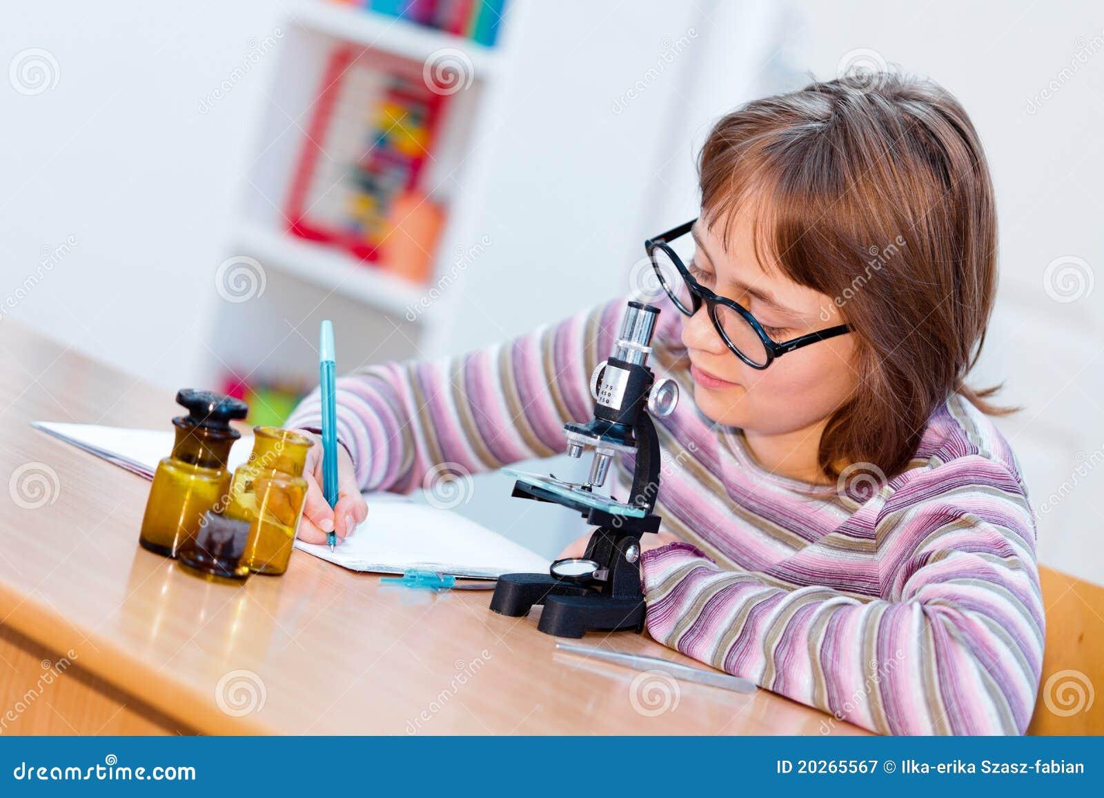 Teen Science Girl Microscope Royalty Free Stock