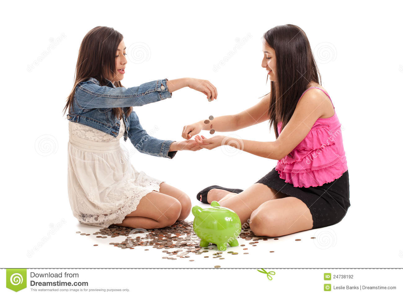 Preteen and teen mixed raced sisters counting money from their piggy ...