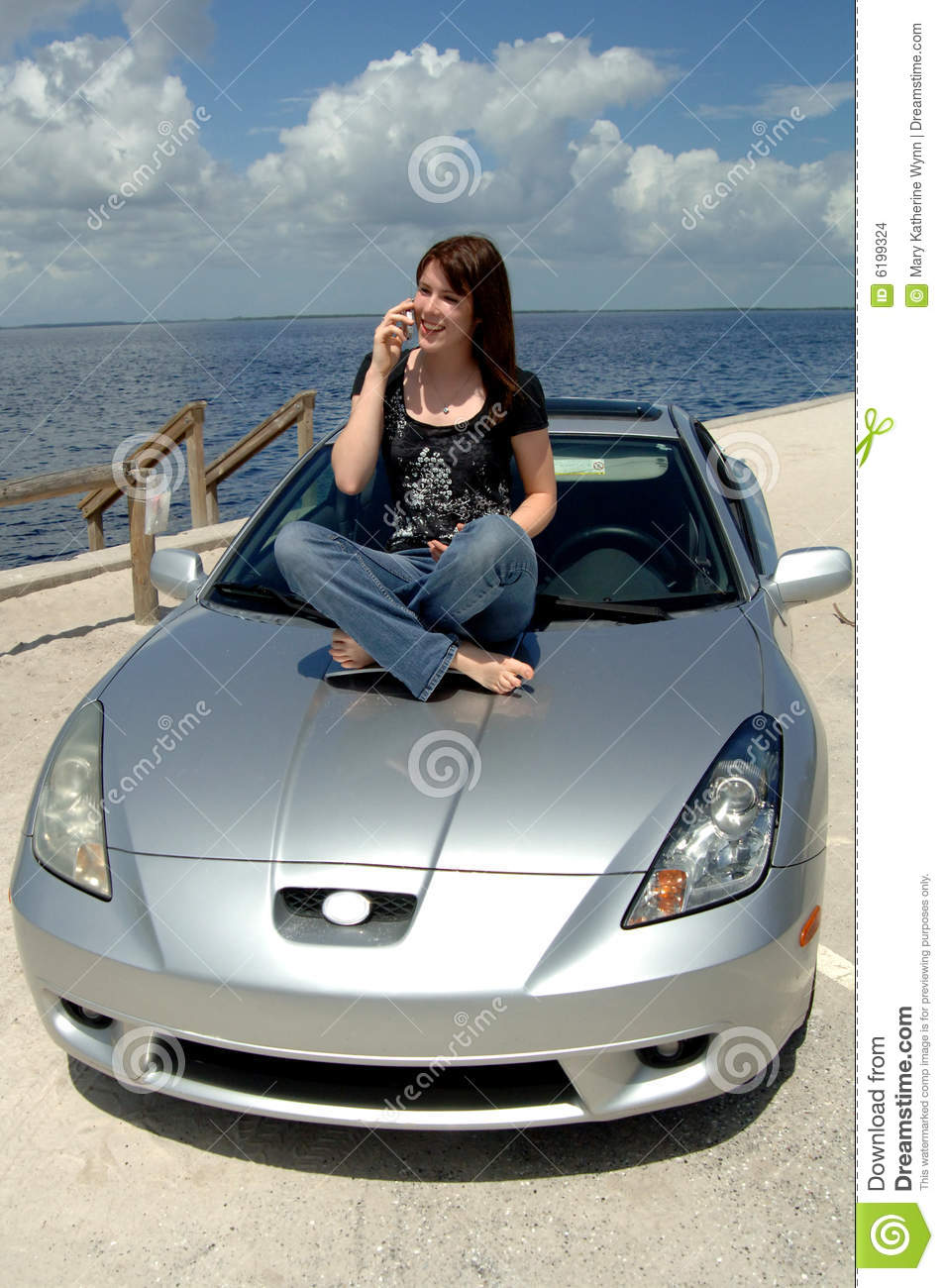 teen sitting on car hood on cell phone stock images image 6199324. Black Bedroom Furniture Sets. Home Design Ideas