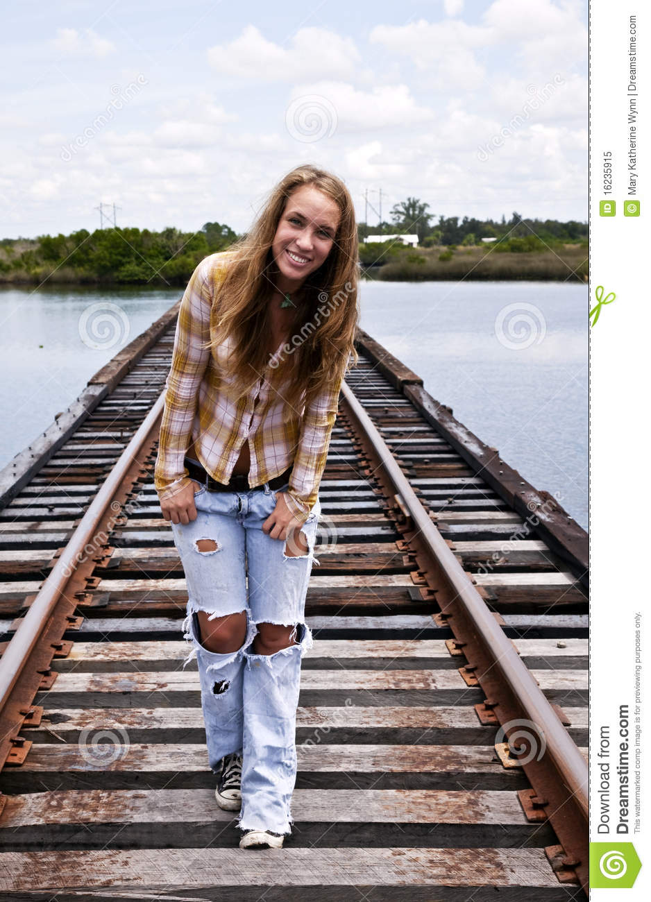 teen girl on railroad tracks