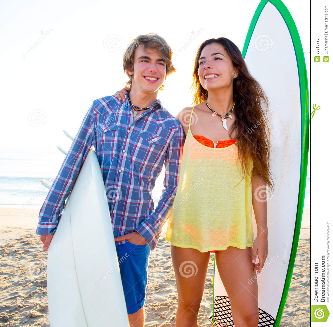 Teen Surfer Couple On Beach Shore With Surf Boards Stock