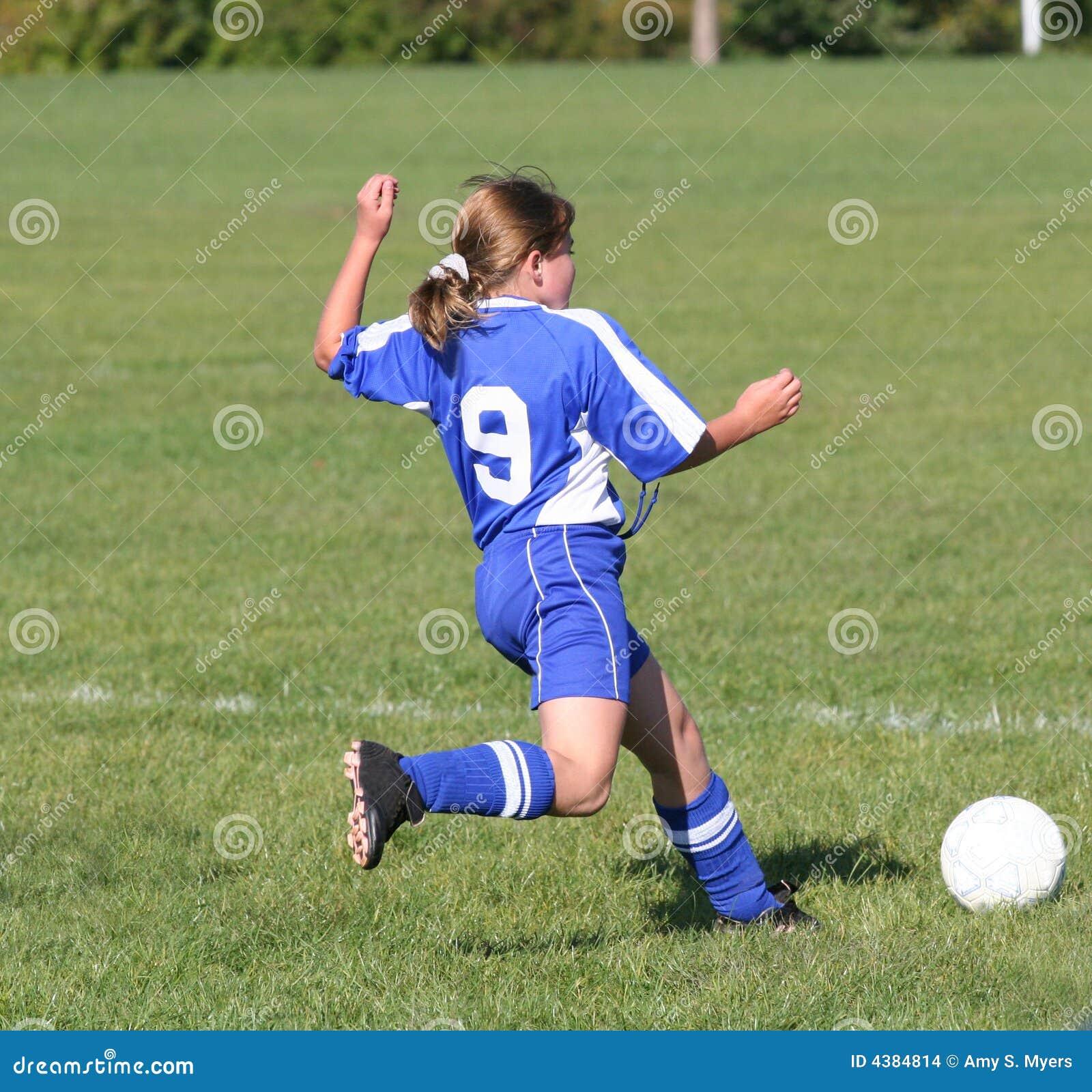 Balance Ball Kick: Teen Youth Soccer Kicking Ball Stock Photo