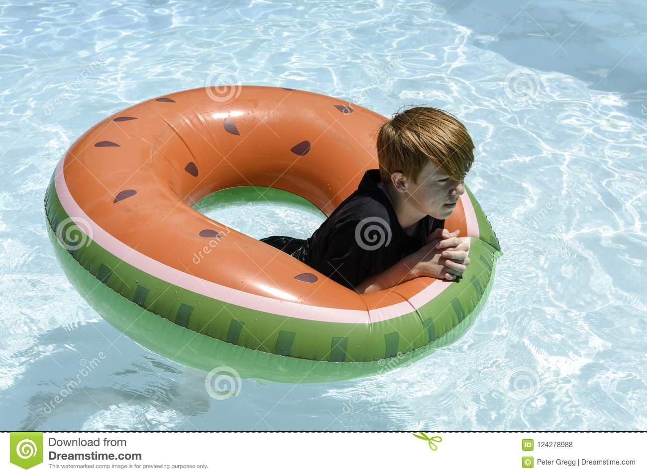 Teenage boy in floatie