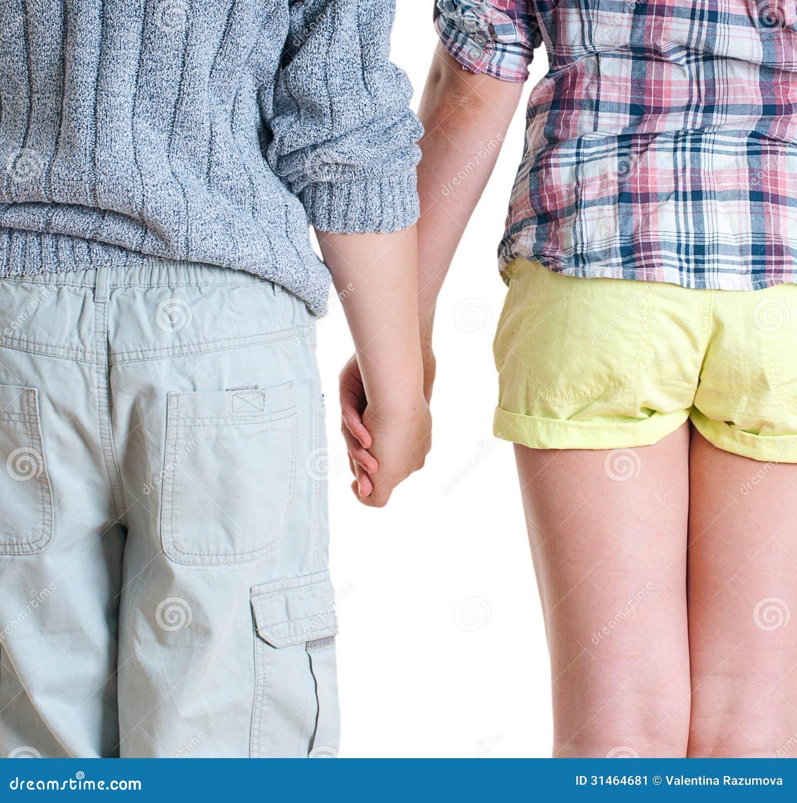 teen boys hold hands