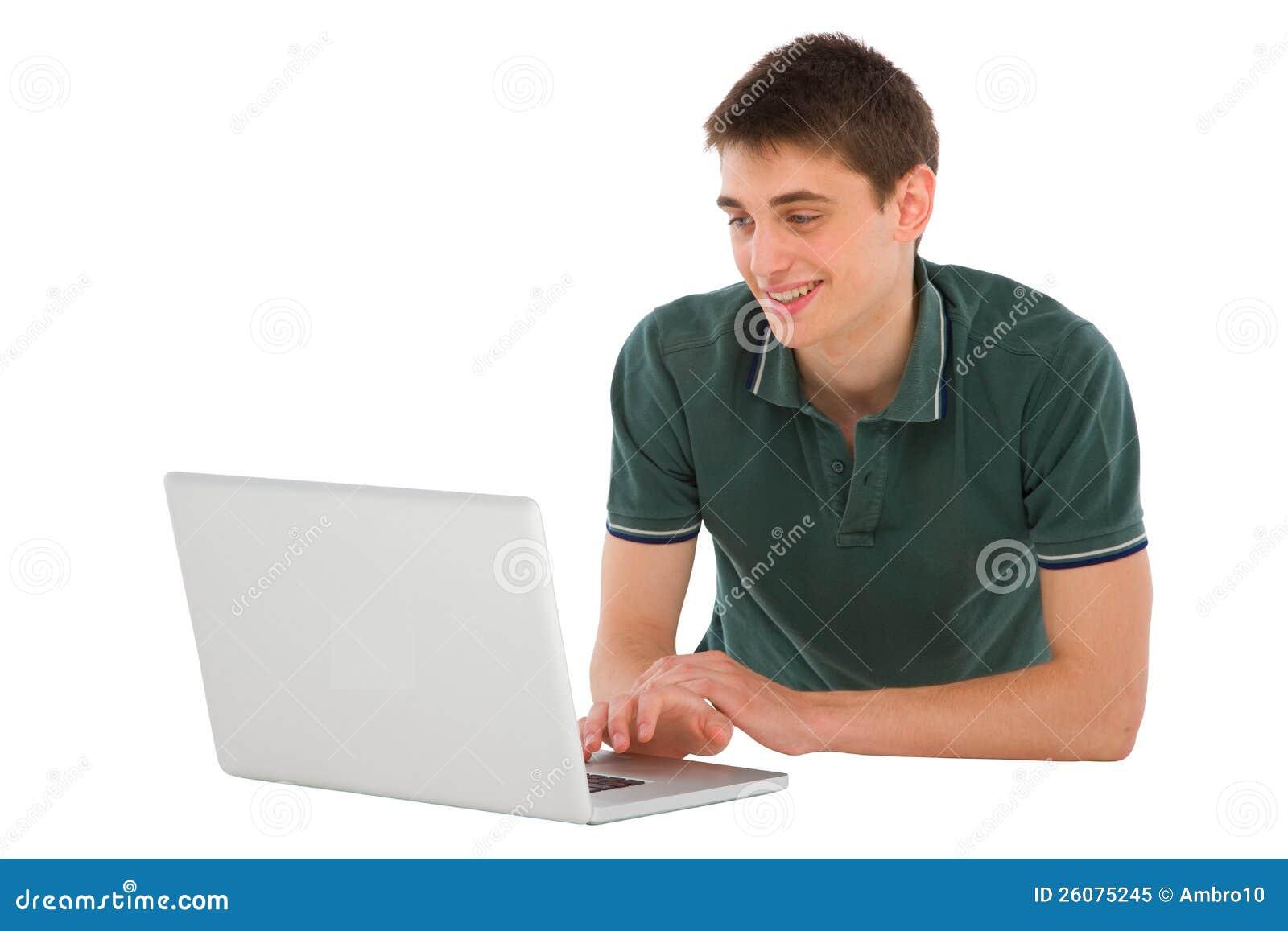 Teenage boy with laptop lying down