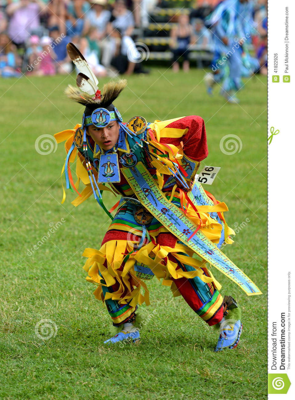 Teenage boy performs traditional native dance editorial photo image