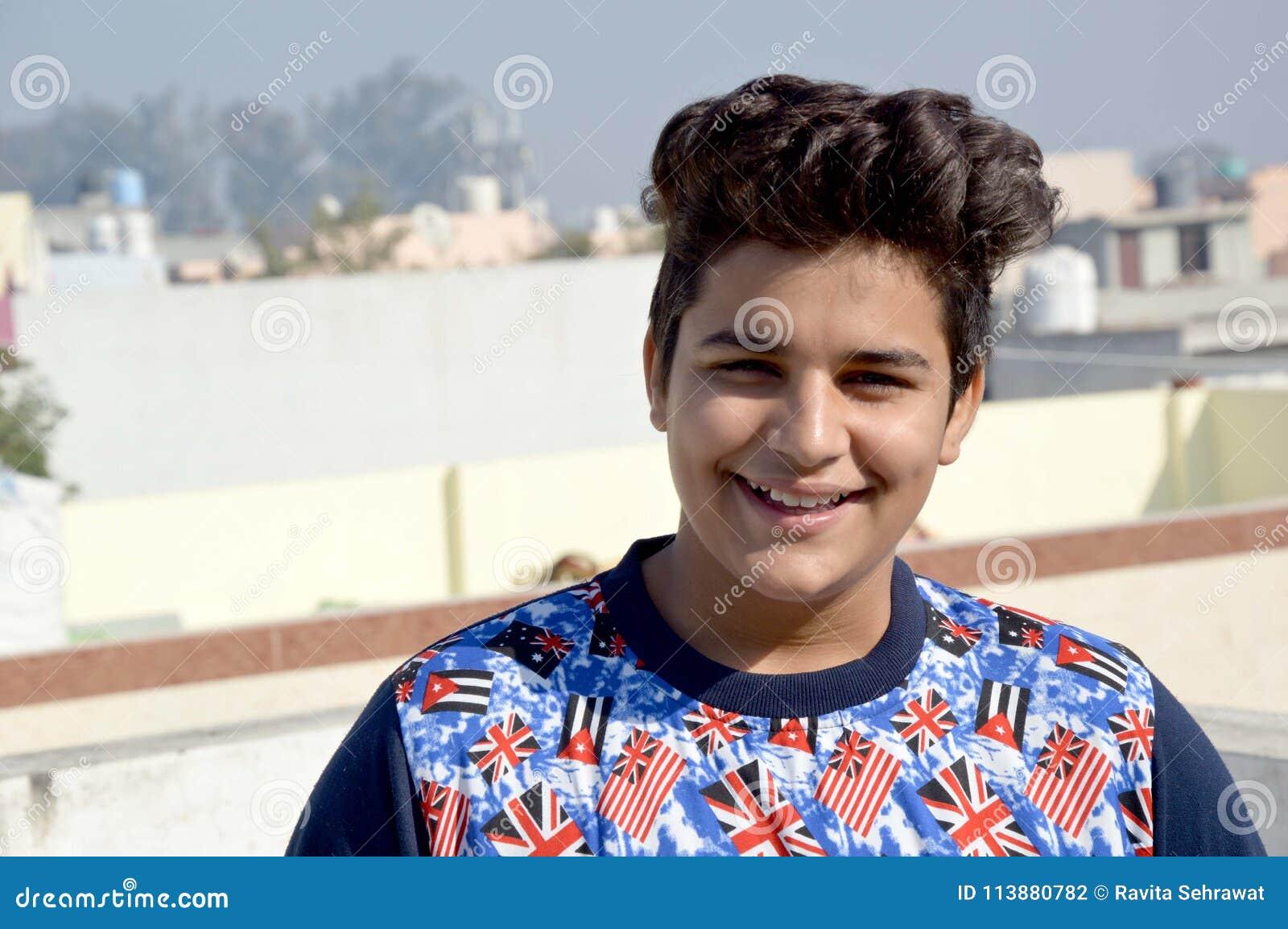 Teenage Boy Standing On House Roof For Taking Sunbath  Stock