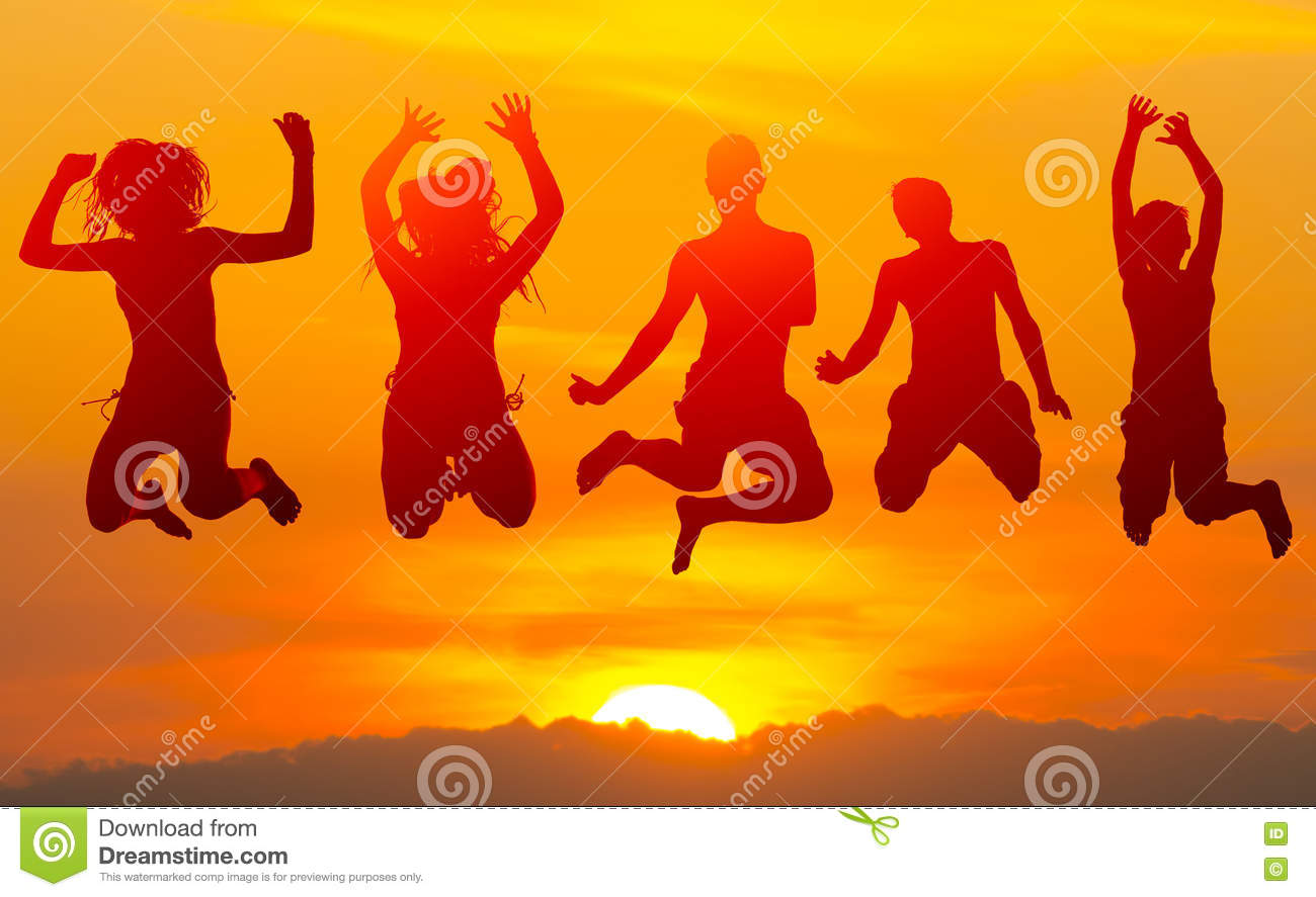 People Jumping In The Air At Sunset