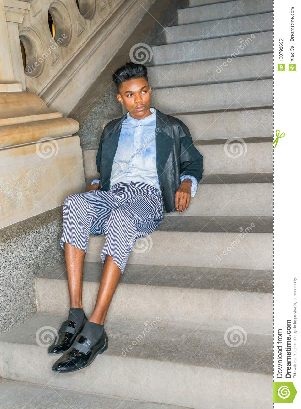 A Young Dark Skin18 Years Old Student Wearing Black Fashionable Leather Wool Mixed Jacketed Pants Blue Dyed White Shirt Leather Shoes